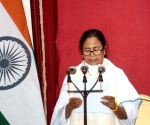 Mamata's 43 ministers take oath sans festivities