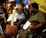 Candle light vigil against GST on disability aids and appliances