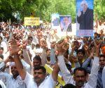 Members of the Satlok Ashram Karontha during a protest rally against Haryana government for attack on Satlok Ashram