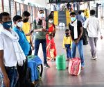 Migrant workers going back on trains vow not to return