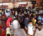 Migrants arriving from Maharashtra stand in a queue at Patna Junction to undergo COVID-19 testing, as coronavirus cases spike countrywide, in Patna