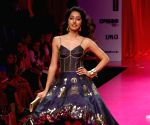 Model walked the ramp for Barbie show at the Lakme fashion week 2009.