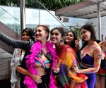 "Models during photoshoot on ""Rainbow – Colors of Pride"