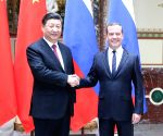 RUSSIA MOSCOW CHINA XI JINPING DMITRY MEDVEDEV MEETING