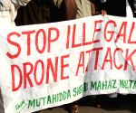 Pakistani people shout slogans during a protest against U.S. drone strikes