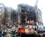 2 firemen injured as burning building crashes in Mumbai
