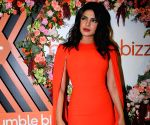 Priyanka makes a style statement in fiery orange dress