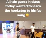 Tiger Shroff tries to teach a child the hook step of his 'War' song