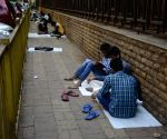 Students prepare for board exams on Mumbai pavements