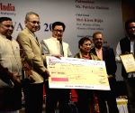 Kiren Rijiju confers ONE India Award 2014 to Patricia Mukhim