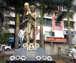 Free Photo: Municipal workers clean the statue of Diego Maradona, in Kolkata on Nov 26, 2020