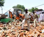 Municipality staff carry out demolition drive