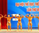 Nam Dinh (Vietnam): Body builders perform during the seventh Vietnam's National Sports Games