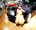Small kids during the 2013 Nanjing Auto Expo in Nanjing