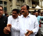 Karnataka's 12 BJP members take oath as MLAs