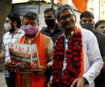 Kolkata :National General Secretary, Kailash Vijayvargiya along with BJP candidate of Maniktala constituency Kalyan Chawby at a election campaign for the State Assembly election in Kolkata on 13 April,2021.
