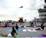 International Yoga Day  - Navy personnel practice Yoga