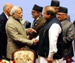 PM Modi shakes hands with Nawaz Sharif at the 18th SAARC Summit