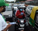 : New Delhi :A volunteer distributes pamphlet at a traffic point as a part of Delhi governments Red Light on,Gaadi off  campaign to reduce pollution in The National Capital
