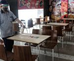 New Delhi : A worker of Haldiram restaurant sanitize and cleaning restaurant for reopening on Monday after DDMA orders to reopening at Connaught Place in New Delhi.