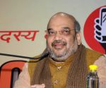 Amit Shah addressing a gathering of businessmen