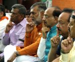 BJP holds silent protest against Mamata government