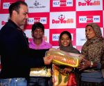 Virender Sehwag during a philanthropic programme