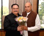 Prem Kumar Dhumal calls on Jagat Prakash Nadda
