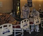 Health workers wearing PPE suits and treatment for COVID-19 positive patient admit in Emergency Covid-19 care center by Delhi Government at Shahnai banquet Hall in front of LNJP hospital in New Delhi on Monday April 12, 2021.