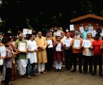 New Delhi:Members from Iskcon Delhi and local people  in a silent candle light protest against the alleged attack on the ISKON Temple at Bangladesh