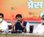 New Delhi : North East Delhi MP Manoj Tiwari along with LOP Ramvir Singh Bidhuri address a press conference on an important issue at BJP State office in in New Delhi.