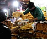New Delhi : People purchased Khajla and Pheni on the eve of Holy Month for Ramadan at Jama Masjid area in New Delhi on Tuesday April 13, 2021.