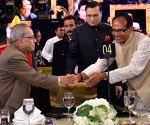 President Mukherjee, PM Modi, Salman Khan during a programme to mark 21 years of a TV show