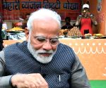 PM Modi munches on 'litti-chokha', 'kulhad chai'