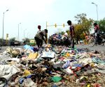 Striking MCD sanitation workers dump garbage on road