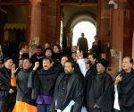 Trinamool MPs use black shawls for black money protest