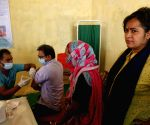 :New Delhi: Vaccinator injects covishield vaccine for Covid-19 vaccination after the inauguration of Union Minister Hardeep Singh Puri at DCM Colony, 30 Feet Road, Ibrahimpur village, in New Delhi