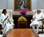 Mamata meets Modi with sandesh, seeks his help
