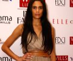 "New model for ""Wills Life Style India Fashion Week-2009"" during a press meet in New Delhi on Saturday."
