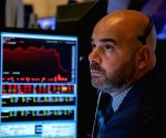 US stocks close slightly lower