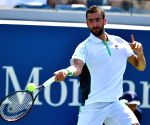 Cilic beats Isner, gets first victory at ATP Finals