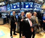 Traders work in the New York Stock Exchange (NYSE) in New York