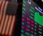 US stocks close lower amid earnings