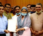 Newly unopposed elected member of Legislative Council(MLC) Rozina Najish flashes the victory sign at Bihar Assembly