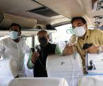 "North Delhi Mayor Jai Prakash and Ravinder Gupta Flag of a bus ""Oxygen on wheels"" at A block Dr SPM Civic Centre in New Delhi"