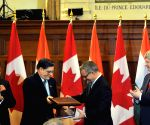 Ottawa (Canada): Modi,Harper during agreement signing ceremony