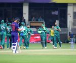 :Dubai: Pakistan cricket celebrates after dismissals of India players during the Cricket Twenty20 World Cup match between India and Pakistan in Dubai.