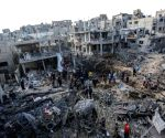 :   Palestinians inspect their destroyed houses in the northern Gaza Strip town of Beit Hanoun, on May 14, 2021