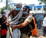 Paramilitary forces personal caring an old woman and comes out from polling station after casting her vote during the 5th phase of State Assembly election at Bidhannagar in Kolkata
