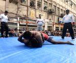 Wrestling and belt wrestling competition